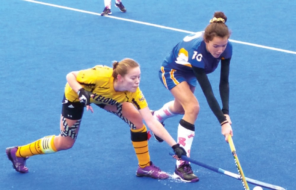 Anya Hermant and Alison Drummond battle for the ball